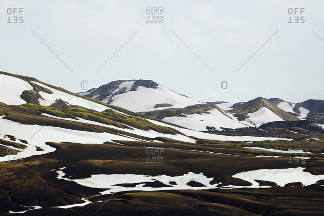 Landscape of snow melting on mountains