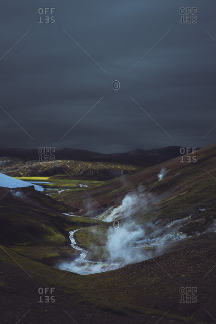 Stormy clouds over mountains and river in Iceland