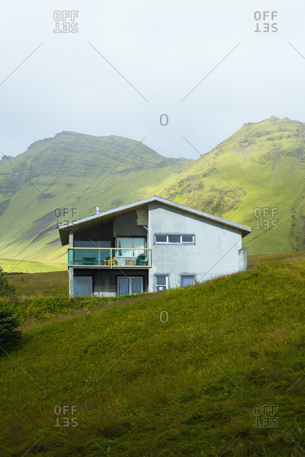 House in green mountains, Vik, Iceland