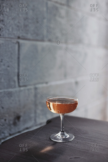 Bubbly cocktail in a coupe glass