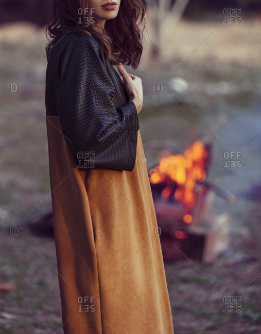 Young woman in the forest wearing a stylish coat