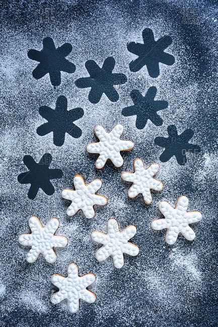 Frosted snowflake cookies sprinkled with powdered sugar