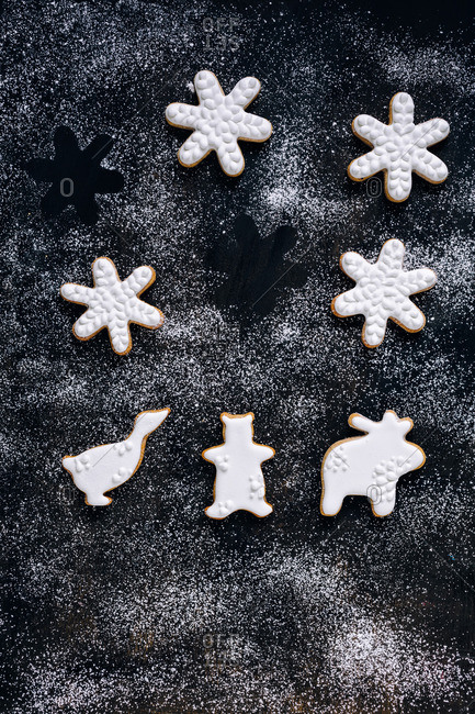 Frosted Christmas cookies sprinkled with powdered sugar