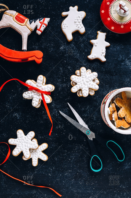 Christmas cookies tied with ribbon and a rocking horse