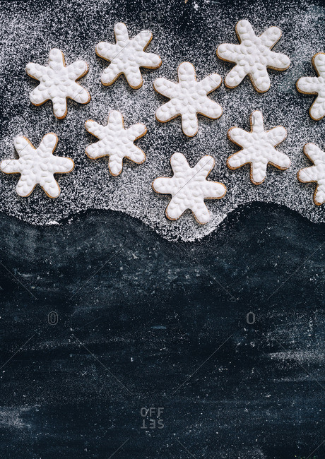Snowflake cookies and a wavy pattern of powdered sugar