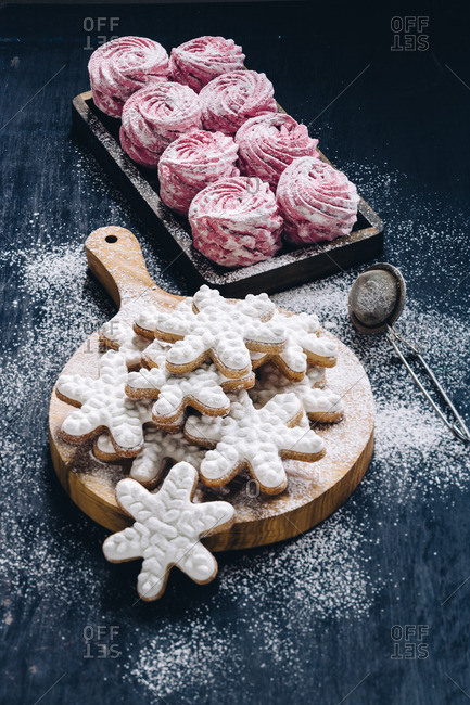Frosted snowflake cookies and meringue cookies dusted with sugar