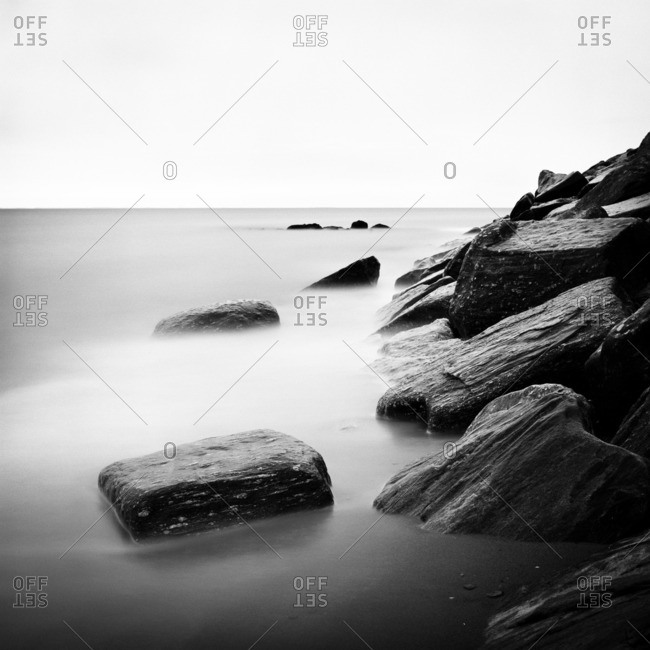 Boulders on coastline in long exposure
