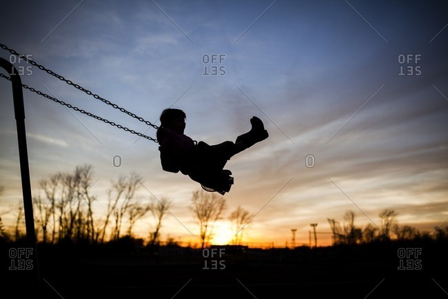 733b0104887c Silhouette girl playing on swing against sky during sunset stock ...