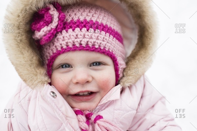 Portrait of cute smiling girl in warm clothing