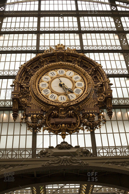 Paris, France - June 26, 2012: Low angle view of ornate clock at Musee d'Orsay