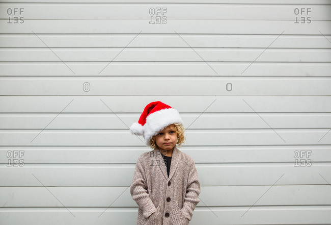 Boy in Santa hat and cardigan