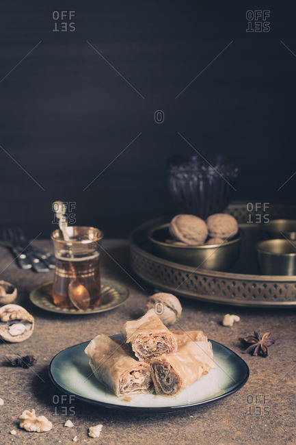 Turkish baklava served with tea and walnuts