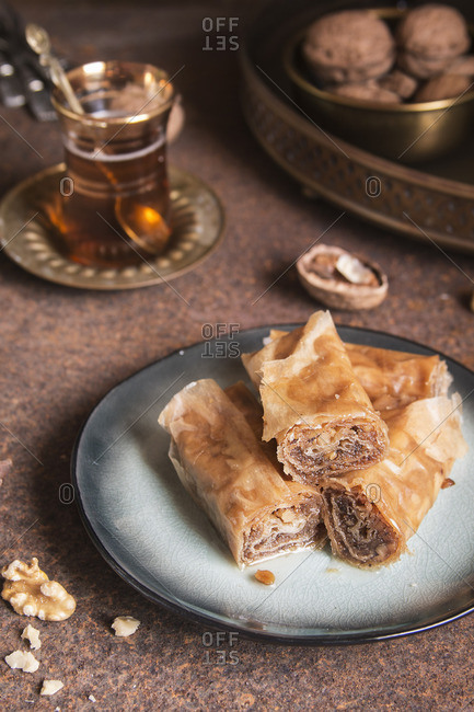 Close up of Turkish baklava served on a plate with tea