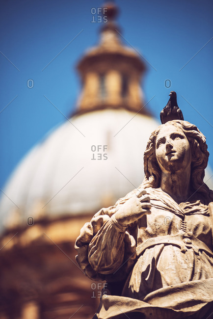 Bird on a statue in Palermo city, Sicily, Italy