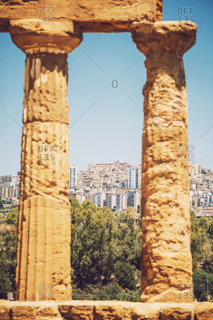 View through columns at the Valley of the Temples in Agrigento, Sicily, Italy