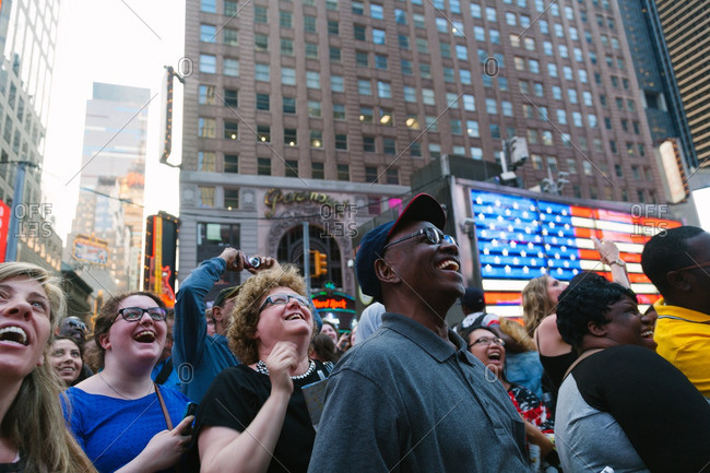 NEW YORK CITY, NEW YORK - JUNE 11, 2015: People having fun with the Screen Shows in Times Square