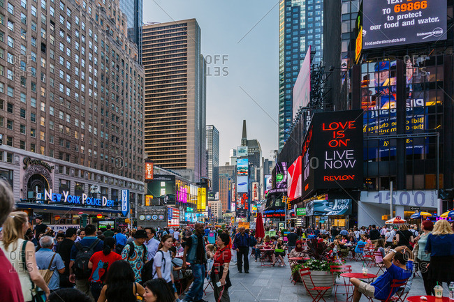 NEW YORK CITY, NEW YORK - JUNE 11, 2015: Crowd of tourists in Times Square