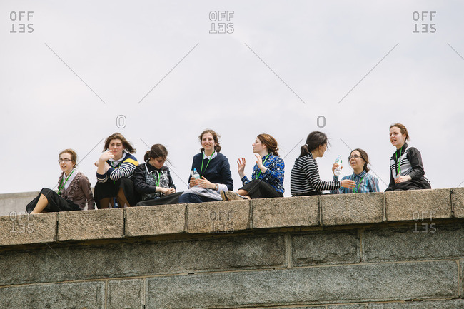 NEW YORK CITY, NEW YORK - JUNE 11, 2015: Group of young Amish women visiting the Statue of Liberty