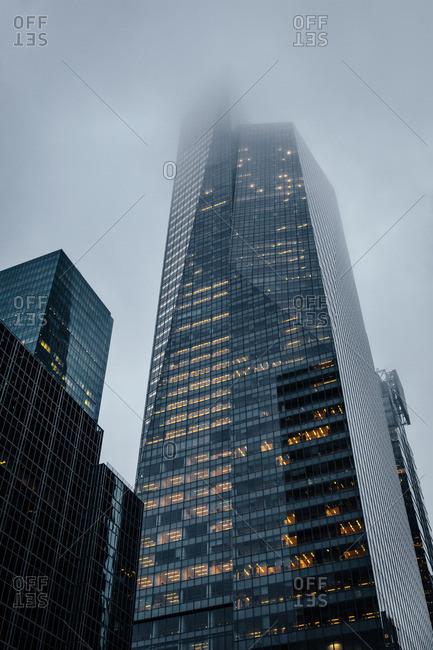 Office skyscraper on a foggy day