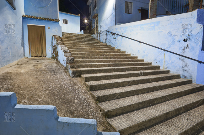 Blue buildings and steps in the village of Juzcar, Spain