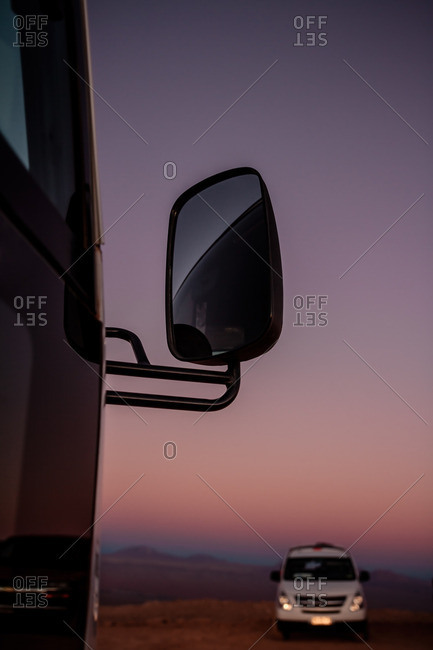 Colorful sunset and van mirror in the Valley of the Moon in the Atacama desert, Chile