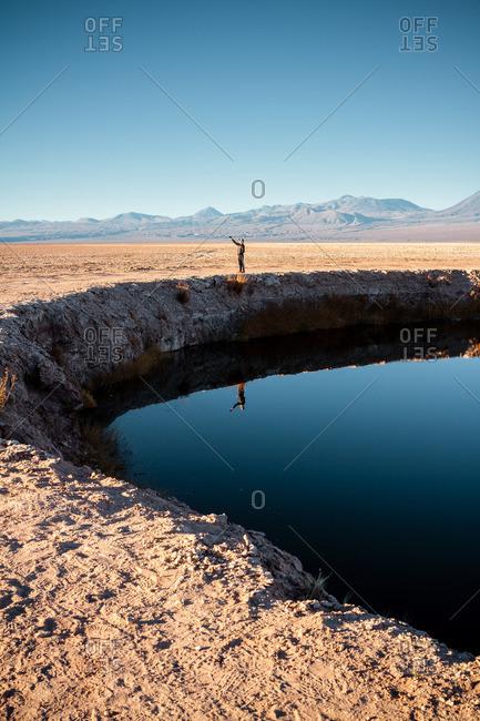 Tourist standing by Laguna Cejar, San Pedro de Atacama, Chile