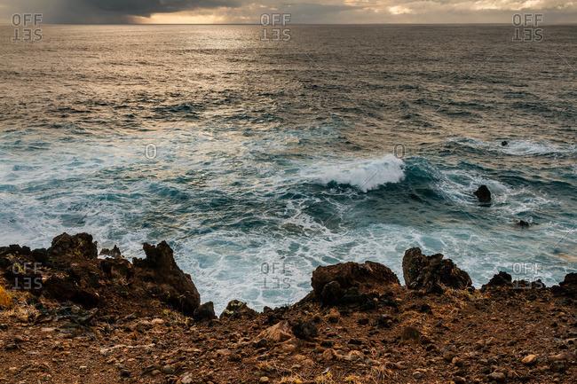 Waves crashing on rocky shore