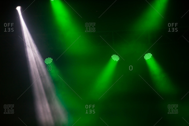 Shining led spotlights at concert with foggy background