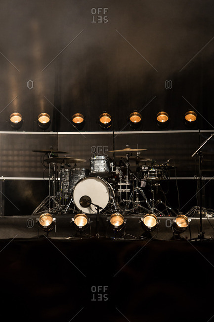 Drum set at a concert with spotlights
