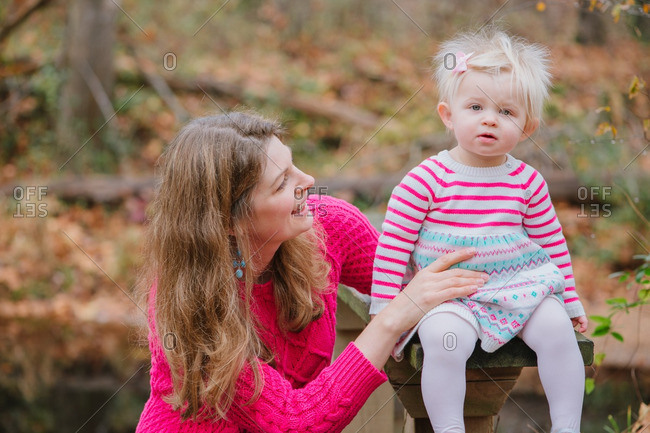 Mom with blonde toddler girl in rural setting