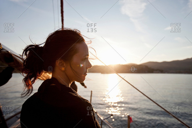 woman on a boat watching the sunset