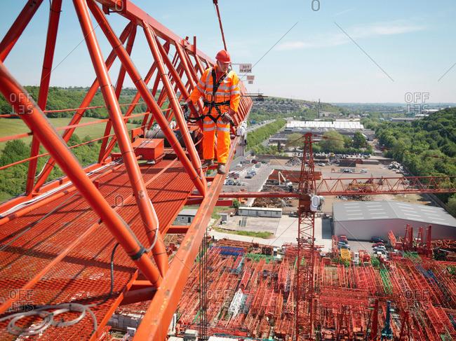 Crane Worker Walking Along Crane