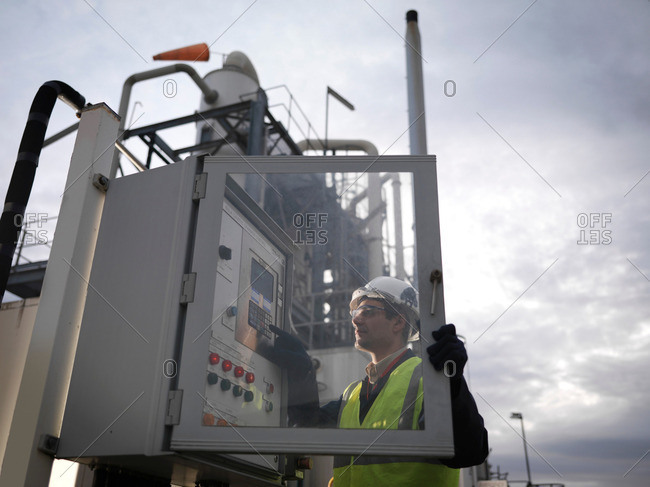 Port Worker Working With Control Panel