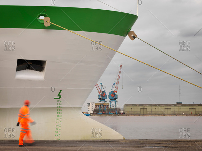 Port Worker With Ship At Port