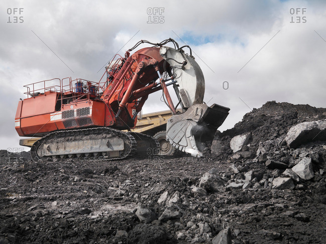 Red Digger Working In Coal Mine