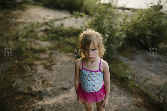 Little girl in a bathing suit making an angry face