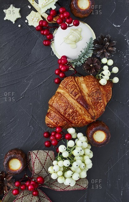 Various Christmas treats on dark background