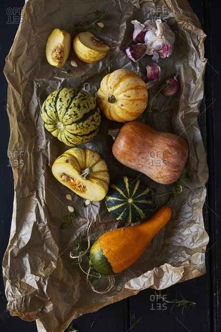 Seasonal squashes on brown paper
