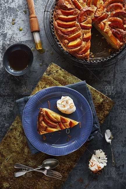 Persimmon tart with cream and orange zest