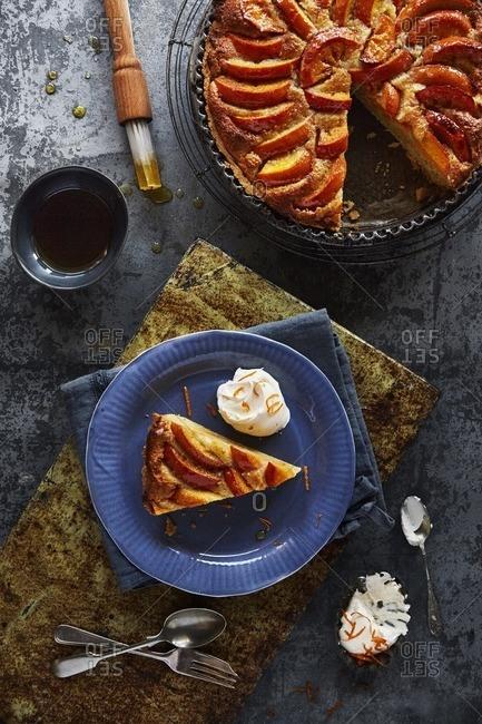 Persimmon tart with cream and orange zest