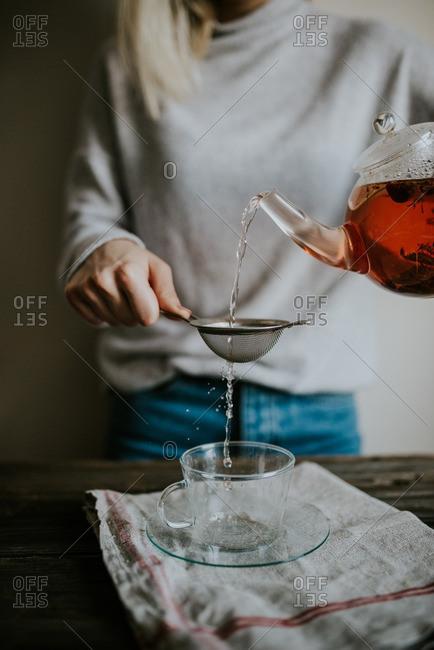 Woman preparing cup of tea
