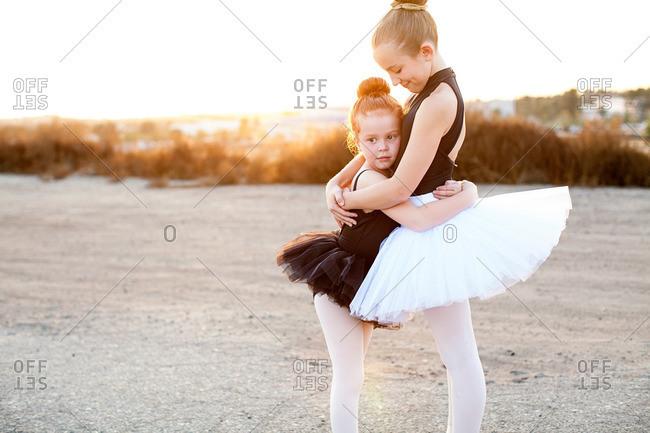 Two ballerinas hugging