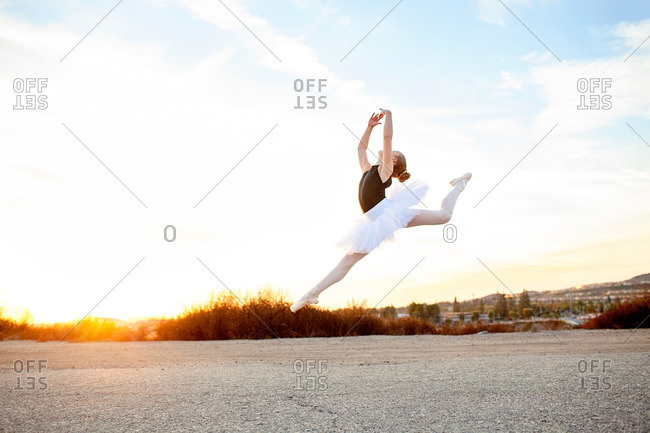 Girl in ballet costume leaping in the air