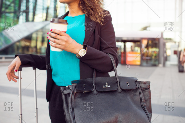 Businesswoman standing by central station