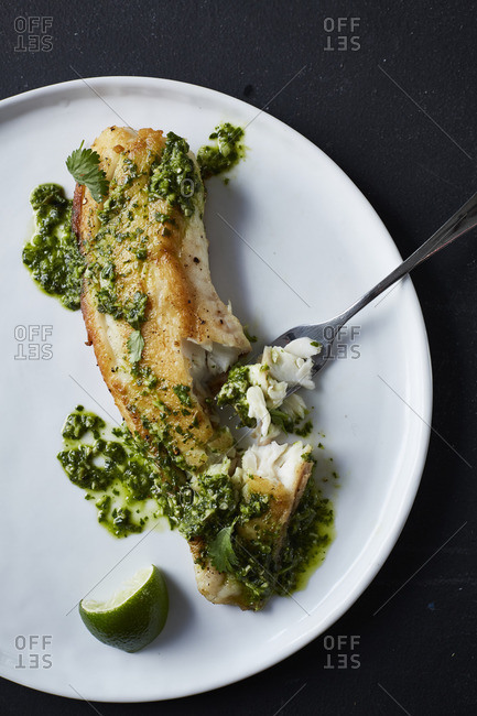 Roasted fish topped with pesto