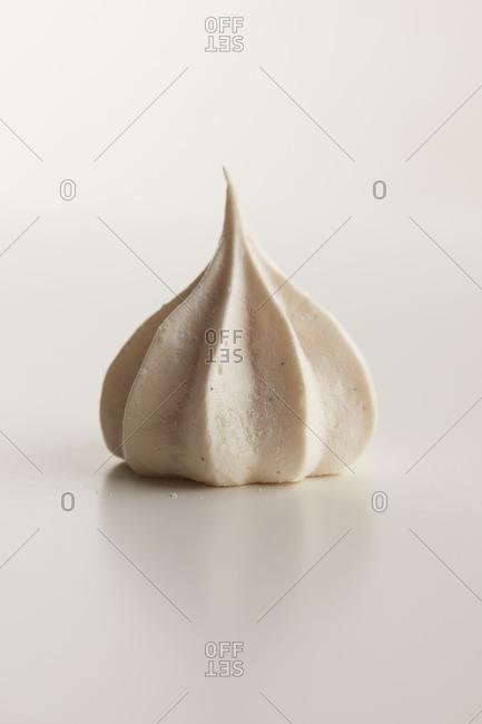 White meringue on a white background