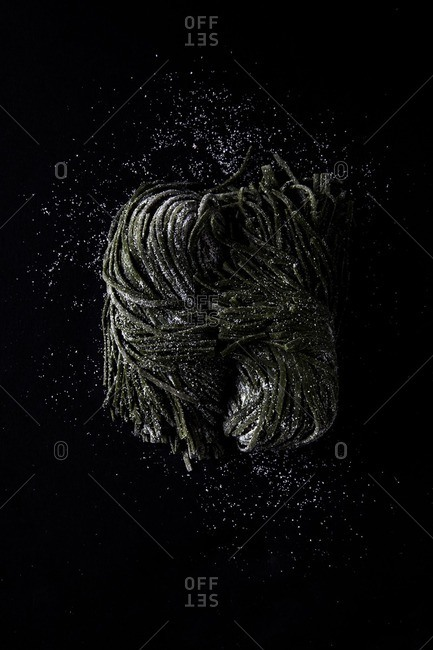 Pile of pasta on dark background