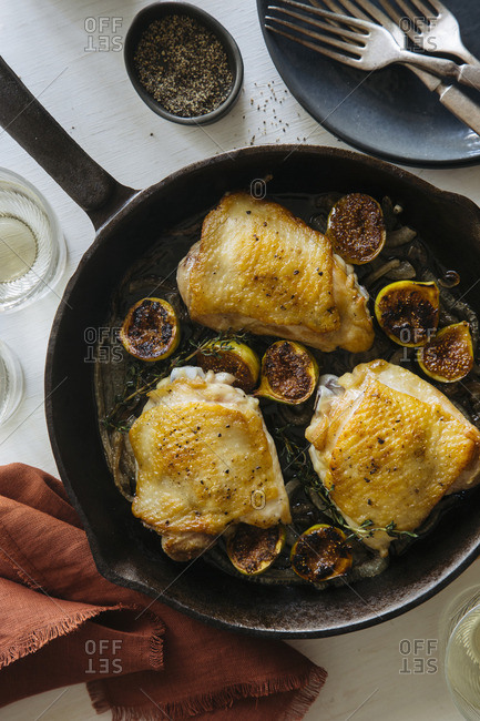 Skillet with roasted chicken thighs and fig