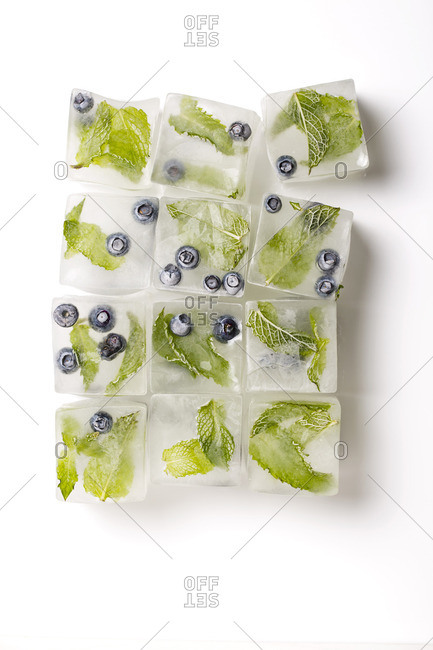 Blueberries and mint frozen into ice cubes