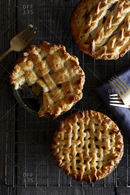 Miniature pies on cooling rack with forks